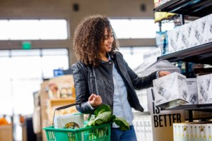 Young African-American woman grocery shopping